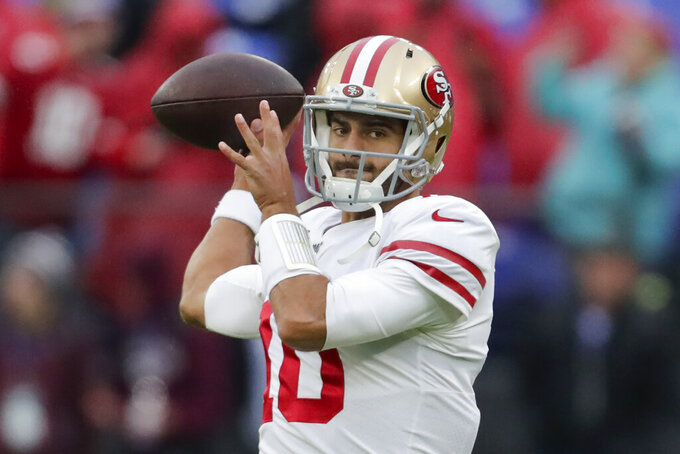 San Francisco 49ers quarterback Jimmy Garoppolo warms up on the field before the start of an NFL football game against the Baltimore Ravens, Sunday, Dec. 1, 2019, in Baltimore, Md. (AP Photo/Julio Cortez)