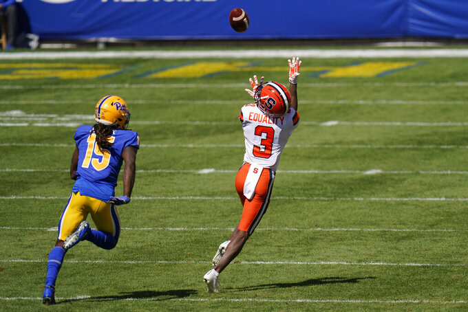 Syracuse wide receiver Taj Harris (3) makes a touchdown catch ahead of Pittsburgh defensive back Jason Pinnock (15) during the first half of an NCAA college football game, Saturday, Sept. 19, 2020, in Pittsburgh. (AP Photo/Keith Srakocic)