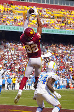 Washington Football Team tight end Logan Thomas (82) makes a touchdown catch against Los Angeles Chargers defensive back Nasir Adderley (24) during the second half of an NFL football game, Sunday, Sept. 12, 2021, in Landover, Md. (AP Photo/Andrew Harnik)