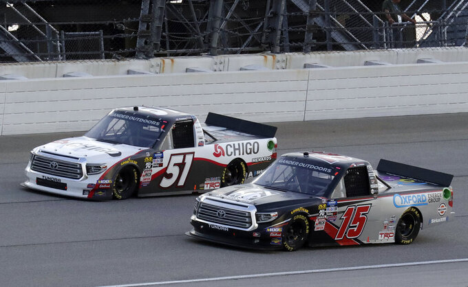 Brandon Jones, left, and Anthony Alfredo drive during a NASCAR Truck Series auto race at Chicagoland Speedway in Joliet, Ill., Friday, June 28, 2019. (AP Photo/Nam Y. Huh)