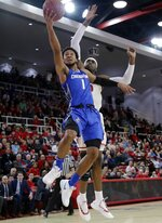 Creighton's Davion Mintz (1) drives past St. John's Sedee Keita (0) during the first half of an NCAA college basketball game Wednesday, Jan. 16, 2019, in New York. (AP Photo/Frank Franklin II)
