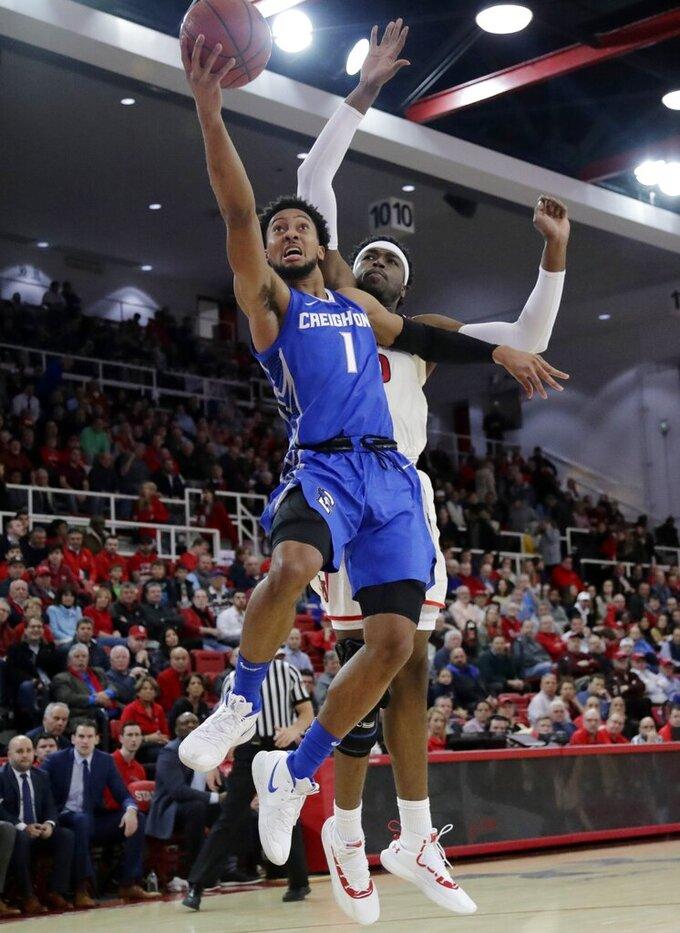 Creighton's Davion Mintz (1) drives past St. John's Sedee Keita (0) during the first half of an NCAA college basketball game Wednesday, Jan. 16, 2019, in New York. (AP Photo/Frank Franklin II)