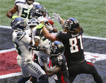 Seattle Seahawks free safety Quandre Diggs, center, goes up for an interception in the end zone on a pass to Atlanta Falcons tight end Hayden Hurst, right, and wide receiver Calvin Ridley (18) during an NFL football game Sunday, Sept. 13, 2020, in Atlanta. (Curtis Compton/Atlanta Journal-Constitution via AP)