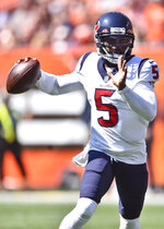 Houston Texans quarterback Tyrod Taylor looks to throw during the first half of an NFL football game against the Cleveland Browns, Sunday, Sept. 19, 2021, in Cleveland. (AP Photo/David Richard)
