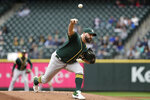 Oakland Athletics starting pitcher Tanner Roark throws against the Seattle Mariners in the first inning of a baseball game Sunday, Sept. 29, 2019, in Seattle. (AP Photo/Elaine Thompson)