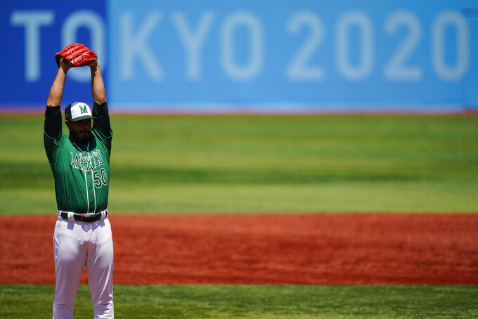 Mexico's Manuel Barrera stretches while pitching during a baseball game against Israel at Yokohama Baseball Stadium during the 2020 Summer Olympics, Sunday, Aug. 1, 2021, in Yokohama, Japan. (AP Photo/Matt Slocum)