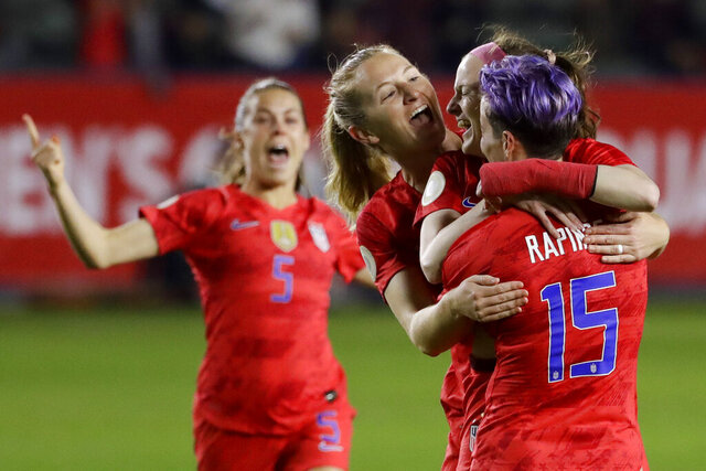 U.S. players celebrate after a goal by midfielder Rose Lavelle, second from right, during the first half of a CONCACAF women's Olympic qualifying soccer match against Mexico on Friday, Feb. 7, 2020, in Carson, Calif. (AP Photo/Chris Carlson)
