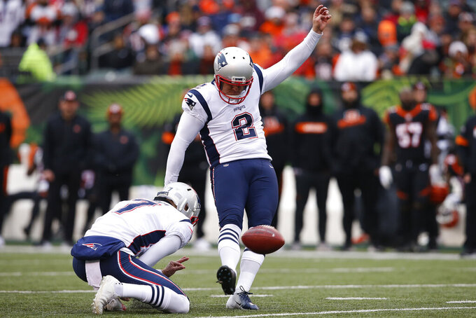 New England Patriots kicker Nick Folk (2) kicks a field goal in the first half of an NFL football game against the Cincinnati Bengals, Sunday, Dec. 15, 2019, in Cincinnati. (AP Photo/Gary Landers)
