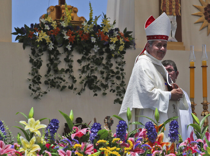 FILE - In this Jan. 18, 2018 photo,  Juan Barros, Bishop of Osornos, smiles as he leaves the altar at the end of a Mass celebrated by Pope Francis on Lobito Beach in Iquique, Chile. The pope's remarks defending Barros during his January visit drew shock from Chileans and immediate rebuke from victims and advocates worldwide, prompting him to later send the Vatican's sex crimes investigator to investigate Barros, who is accused of helping to cover up the sex crimes of pedophile priest Rev. Fernando Karadima. (AP Photo/Alessandra Tarantino, File)