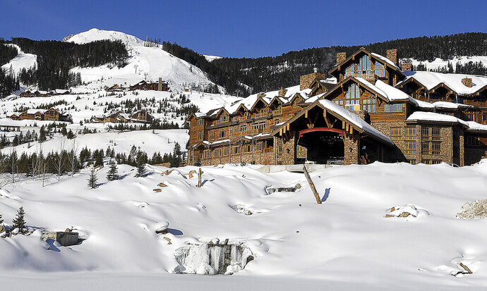 FILE - This undated file photo shows the Yellowstone Club near Big Sky, Mont. It may get tougher for Yellowstone Club members like Bill Gates and Justin Timberlake to get a drink the next time they go skiing at the exclusive club for the ultra-rich in Montana. The state Department of Revenue is threatening to revoke four liquor licenses issued for facilities at the Yellowstone Club for allegedly serving drinks in an unlicensed location and hiding the evidence from inspectors. (Erik Petersen/Bozeman Daily Chronicle via AP, File)