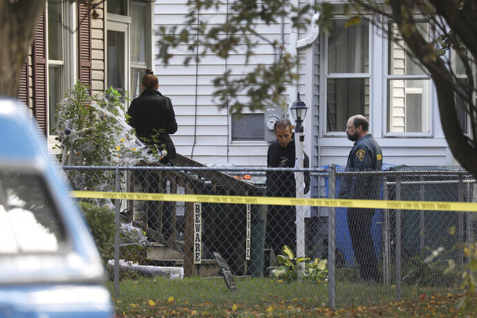 Rochester police look over the area of a home after a fatal shooting at a backyard house party, Saturday, Sept. 19, 2020, in Rochester, N.Y. Police in Rochester, say several people died and others were wounded by gunfire at a backyard party early Saturday. (Tina MacIntyre-Yee/Democrat & Chronicle via AP)