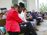 Jennifer Foster, executive director of the One Orlando Alliance, embraces Pulse survivor Joshua Lewis, during the tolling of the bells and the reading of victims' names, at First United Methodist Church in Orlando, Fla., Wednesday, June 12, 2019, the 3rd anniversary of the Pulse nightclub massacre. (Joe Burbank/Orlando Sentinel via AP)