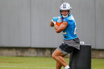 Carolina Panthers running back Christian McCaffrey protects the football as he runs drills during the NFL football team's training camp practice Sunday, Aug. 16, 2020 in Charlotte, N.C. (AP Photo/Nell Redmond)