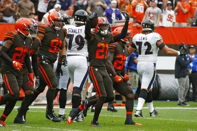 FILE - In this Sunday, Oct. 7, 2018, file photo, Cleveland Browns defensive back Denzel Ward (21) celebrates with teammates after an interception during the first half of an NFL football game against the Baltimore Ravens in Cleveland. With eight interceptions and seven forced fumbles in five games, Cleveland's defense leads the NFL with 15 takeaways, two more than the Browns recorded during 16 games in their winless 2017 season. (AP Photo/Ron Schwane, File)