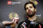 "FILE  - In this Sept. 14, 2018, file photo, Chicago Blackhawks goalie Corey Crawford speaks at a news conference after NHL hockey training camp at the MB Ice Arena, in Chicago. The Blackhawks will not re-sign goaltender Corey Crawford in free agency, potentially signaling a more extensive rebuild for one of the NHL's marquee franchises. General manager Stan Bowman said he had a ""bit of an emotional"" conversation with Crawford on Thursday, Oct. 8, 2020. (AP Photo/Nam Y. Huh, File)"