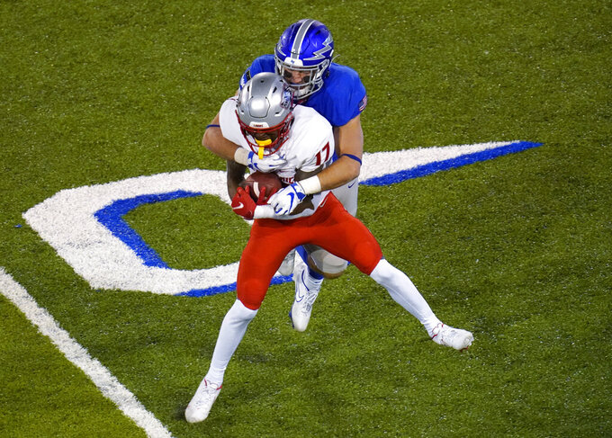 New Mexico wide receiver Emmanuel Logan-Greene, front, is tackled, following a reception, by Air Force linebacker Parker Noren during the second half of an NCAA college football game Friday, Nov. 20, 2020, at Air Force Academy, Colo. (AP Photo/David Zalubowski)