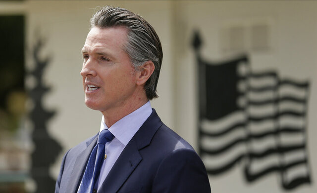 FILE - In this Friday, May 22, 2020, file photo, California Gov. Gavin Newsom speaks during a news conference at the Veterans Home of California in Yountville, Calif. A remote Northern California county that had been one of the state's two counties without any reported coronavirus cases now has at least five cases. Lassen County is temporarily rescinding its order allowing the reopening of restaurants, shopping and other services. (AP Photo/Eric Risberg, Pool, File)