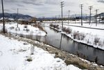 FILE - In this Jan. 18, 2018, file photo, the Silver Bow Creek, left, enters Blacktail Creek in Butte, Mont. This is an area that Environmental Protection Agency, the state, the county, and Atlantic Richfield Company, ARCO have been fighting over during 12 years of confidential negotiations. The head of the U.S. Environmental Protection Agency was scheduled to visit two contaminated mining industry sites in Montana on Friday, Sept. 7, 2018 as the agency faces pressure to speed cleanup work that's dragged on for more than three decades. (Walter Hinick/The Montana Standard via AP, File)