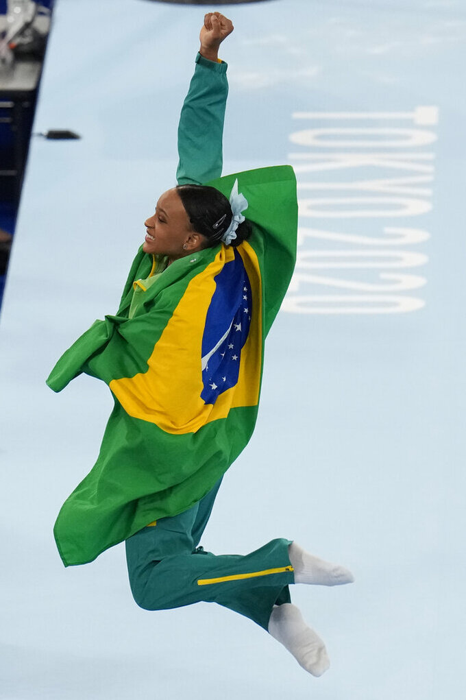Rebeca Andrade of Brazil, celebrates after winning the gold medal on the vault during the artistic gymnastics women's apparatus final at the 2020 Summer Olympics, Sunday, Aug. 1, 2021, in Tokyo, Japan. (AP Photo/Gregory Bull)