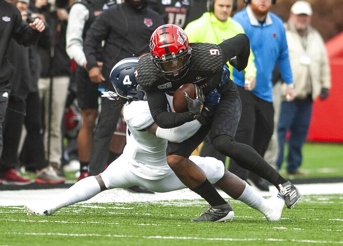 Arkansas State wide receiver Jonathan Adams Jr (9) is tackled by Georgia Southern cornerback Monquavion Brinson (4) after making a catch during the first half of an NCAA college football game against Georgia Southern, Saturday, Nov. 23, 2019, at Centennial Bank Stadium in Jonesboro, Ark. (Quentin Winstine/The Jonesboro Sun via AP)