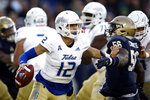 Tulsa quarterback Seth Boomer (12) pushes off Navy linebacker Nizaire Cromartie as he looks for a receiver in the first half of an NCAA college football game, Saturday, Nov. 17, 2018, in Annapolis, Md. (AP Photo/Patrick Semansky)