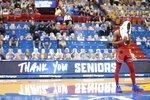 Kansas guard Marcus Garrett reacts while talking about his upbringing during a special ceremony following an NCAA college basketball game against Baylor in Lawrence, Kan., Saturday, Feb. 27, 2021. (Evert Nelson/The Topeka Capital-Journal via AP)