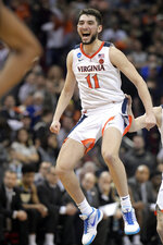 Virginia's Ty Jerome celebrates during overtime of the men's NCAA Tournament college basketball South Regional final game against Purdue, Saturday, March 30, 2019, in Louisville, Ky. Virginia won 80-75.(AP Photo/Timothy D. Easley)