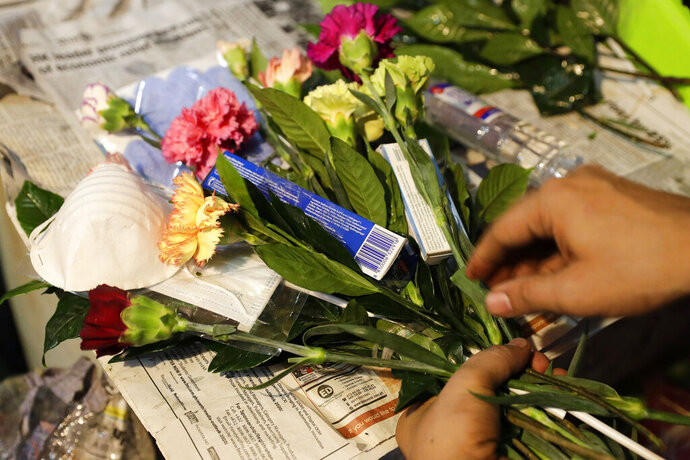 A man arranges a Valentines flower arrangement which they called