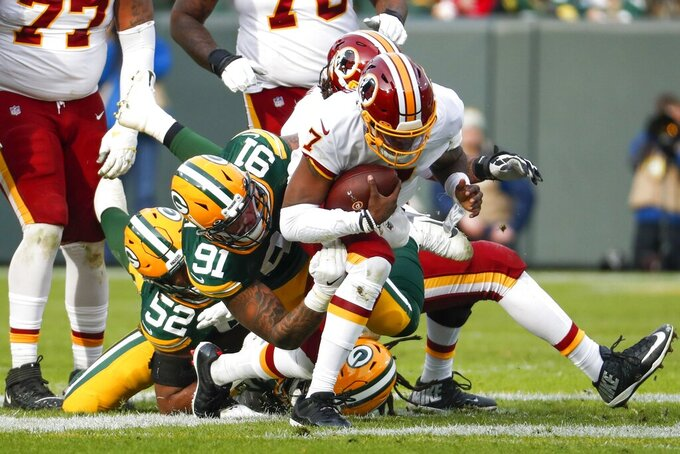 Green Bay Packers' Preston Smith sacks Washington Redskins quarterback Dwayne Haskins during the first half of an NFL football game Sunday, Dec. 8, 2019, in Green Bay, Wis. (AP Photo/Matt Ludtke)