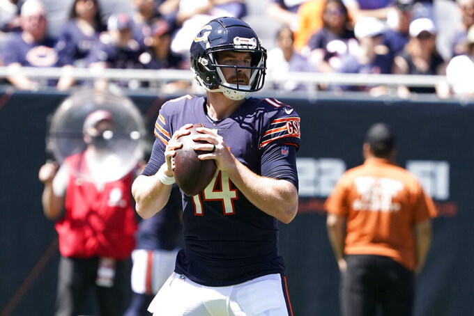 Chicago Bears quarterback Andy Dalton (14) looks to pass against the Miami Dolphins during the first half of an NFL preseason football game in Chicago, Saturday, Aug. 14, 2021. (AP Photo/David Banks)