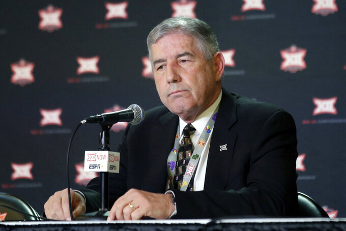 FILE - In this March 11, 2020, file photo, Big 12 Commissioner Bob Bowlsby announces no fans will be admitted to the rest of the Big 12 basketball tournament in Kansas City, Kan. Bowlsby feels good about where the league is with nine teams getting ready to play season openers this week. But the game not being played provides a stark reminder of the uncertainty of playing amid COVID-19. TCU won't be on the field because of a virus outbreak on its campus. (AP Photo/Orlin Wagner, File)