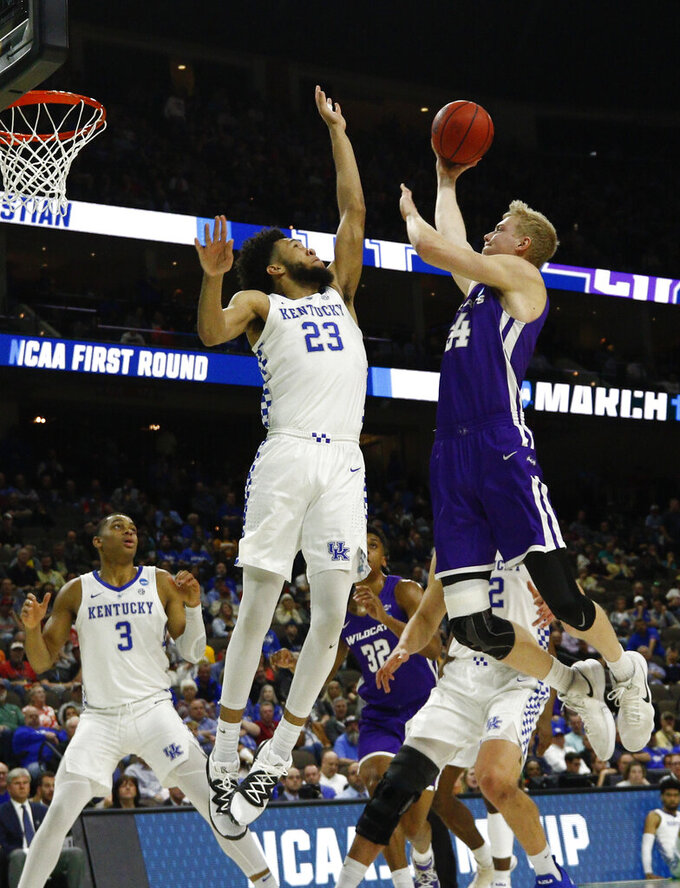 Abilene Christian's Kolton Kohl, right, goes up for a shot against Kentucky's EJ Montgomery (23) during the first half of a first-round game in the NCAA men's college basketball tournament in Jacksonville, Fla., Thursday, March 21, 2019. (AP Photo/Stephen B. Morton)