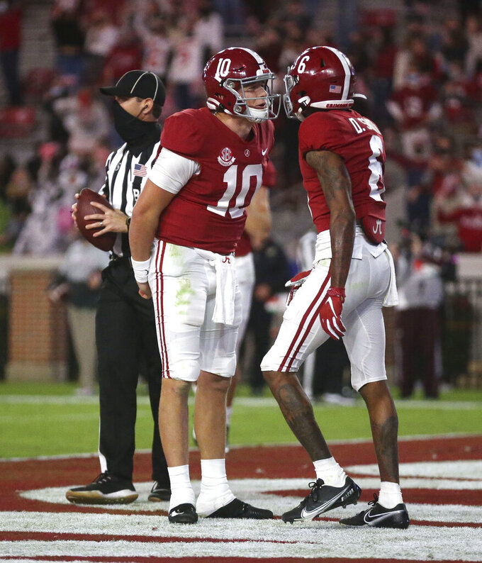 Alabama quarterback Mac Jones (10) celebrates a touchdown pass with wide receiver DeVonta Smith (6) during an NCAA college football game against Mississippi State on Saturday, Oct. 31, 2020, in Tuscaloosa, Ala. (Gary Cosby Jr./The Tuscaloosa News via AP)