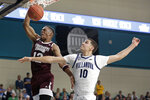 Mississippi State guard Robert Woodard II (12) dunks against Villanova forward Cole Swider (10) during the first half of an NCAA college basketball game at the Myrtle Beach Invitational in Conway, S.C., Friday, Nov. 22, 2019. (AP Photo/Gerry Broome)