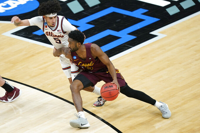 Loyola of Chicago's Keith Clemons, bottom, drives against Illinois' Andre Curbelo during the first half of a college basketball game in the second round of the NCAA tournament at Bankers Life Fieldhouse in Indianapolis Sunday, March 21, 2021. (AP Photo/Mark Humphrey)