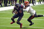 Houston Texans quarterback Deshaun Watson (4) is tackled by Cincinnati Bengals linebacker Germaine Pratt during the first half of an NFL football game Sunday, Dec. 27, 2020, in Houston. (AP Photo/Eric Christian Smith)
