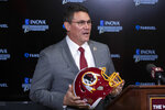 "FILE - In this Jan. 2, 2020, file photo, Washington Redskins head coach Ron Rivera holds up a helmet during a news conference at the team's NFL football training facility in Ashburn, Va. The Washington Redskins are undergoing what the team calls a ""thorough review"" of the nickname. In a statement released Friday, July 3, 2020, the team says it has been talking to the NFL for weeks about the subject. Owner Dan Snyder says the process will include input from alumni, sponsors, the league, community and members of the organization. FedEx on Thursday called for the team to change its name, and Nike appeared to remove all Redskins gear from its online store. (AP Photo/Alex Brandon, File)"