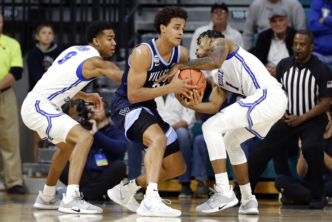 Middle Tennessee State guard Anthony Crump (0) and forward Tyler Millin (1) pressure Villanova forward Jeremiah Robinson-Earl during the first half of an NCAA college basketball game at the Myrtle Beach Invitational in Conway, S.C., Thursday, Nov. 21, 2019. (AP Photo/Gerry Broome)