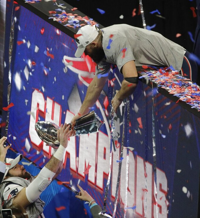 New England Patriots' Julian Edelman (11) holds the Vince Lombardi Trophy after the NFL Super Bowl 53 football game against the Los Angeles Rams, Sunday, Feb. 3, 2019, in Atlanta. The Patriots won 13-3. (AP Photo/Charlie Riedel)