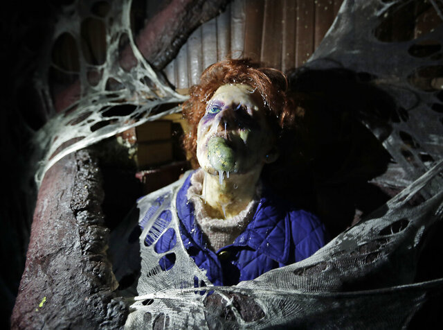 FILE In this Sept. 12, 2018 file photo, the character Barb appears in grand, gory style in the Stranger Things haunted house during Halloween Horror nights at Universal Studios in Orlando, Fla.  Universal said Friday, July 24, 2020,  it wouldn't be hosting the celebration of all things scary at its Universal Orlando Resort and Universal Studios Hollywood so that it could focus on operating its theme parks for daytime guests under pandemic restrictions.  (AP Photo/John Raoux)