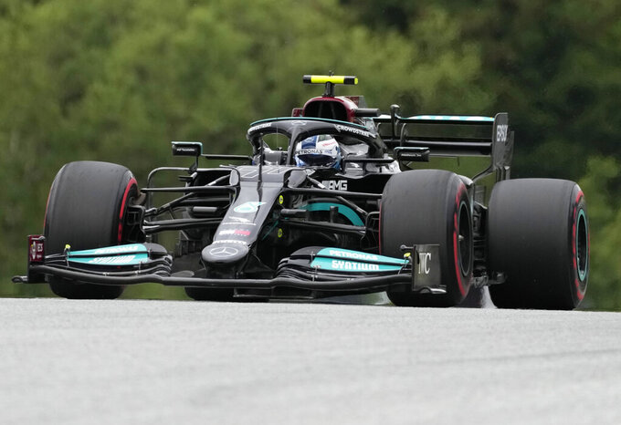Mercedes driver Valtteri Bottas of Finland steers his car during the second free practice session for the Austrian Formula One Grand Prix at the Red Bull Ring racetrack in Spielberg, Austria, Friday, July 2, 2021. The Austrian Grand Prix will be held on Sunday. (AP Photo/Darko Bandic)
