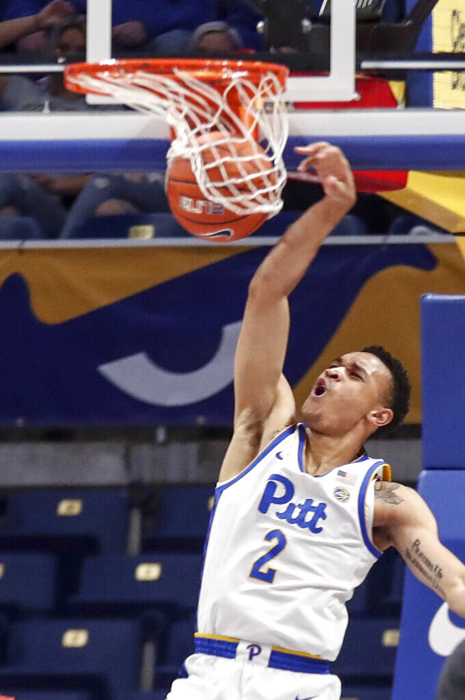 Pittsburgh's Trey McGowens (2) dunks against Northern Illinois during the first half of an NCAA college basketball game, Monday, Dec. 16, 2019, in Pittsburgh. (AP Photo/Keith Srakocic)