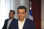 Greek Prime Minister Alexis Tsipras, waits the arrival of U.S. Commerce Secretary Wilbur Ross in the northern port city of Thessaloniki , Greece, on Friday, Sept 7, 2018.Thousands of police officers took up positions Friday around Greece's second-largest city ahead of anti-austerity protests at a trade fair where Tsipras met senior U.S. officials and is set to outline his post-bailout economic policy platform. (AP Photo/Dimitris Tosidis)