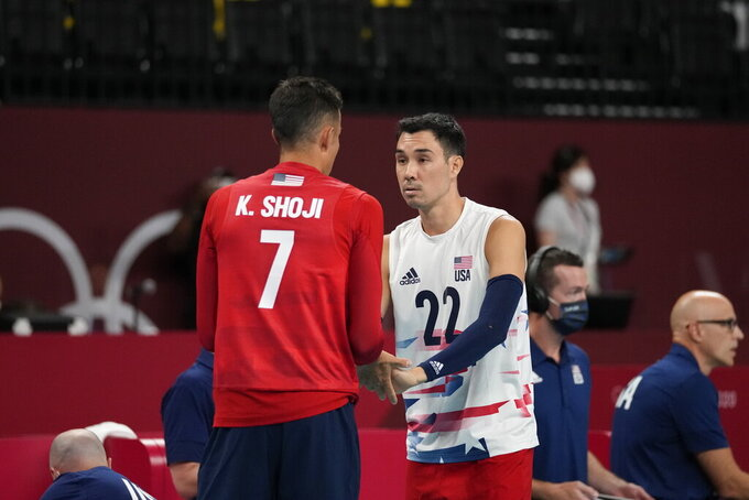 Kawika Shoji and Erik Shoji of the United States' talk on the court during a men's volleyball preliminary round pool B match against France, at the 2020 Summer Olympics, Saturday, July 24, 2021, in Tokyo, Japan. (AP Photo/Frank Augstein)
