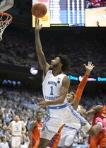 North Carolina's Leaky Black (1) drives to the basket against Clemson's Clyde Trapp (0) in the first half of an NCAA college basketball game on Saturday, Jan. 11, 2020, at the Smith Center in Chapel Hill, N.C. (Robert Willett/The News & Observer via AP)