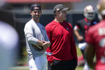 San Francisco 49ers head coach Kyle Shanahan, left, and general manager John Lynch watch players work out at the team's NFL football training facility in Santa Clara, Calif., Tuesday, May 25, 2021. (AP Photo/Jeff Chiu)