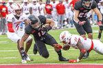 Louisiana-Lafayette running back Elijah Mitchell (15) scores a touchdown against South Alabama safety Dewayne Betts Jr. (27) in the first half an NCAA college football game in Lafayette, La., Saturday, Nov. 14, 2020. (AP Photo/Matthew Hinton)