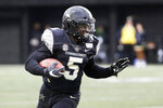 Vanderbilt running back Ke'Shawn Vaughn (5) carries the ball against ETSU in the first half of an NCAA college football game Saturday, Nov. 23, 2019, in Nashville, Tenn. (AP Photo/Mark Humphrey)