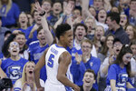 Creighton's Ty-Shon Alexander (5) celebrates after a dunk against DePaul during the first half of an NCAA college basketball game in Omaha, Neb., Saturday, Feb. 15, 2020. (AP Photo/Nati Harnik)