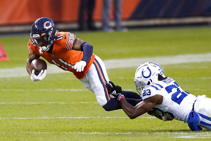 Chicago Bears' Darnell Mooney (11) is tackled by Indianapolis Colts' Kenny Moore II (23) during the second half of an NFL football game Sunday, Oct. 4, 2020, in Chicago. (AP Photo/Nam Y. Huh)